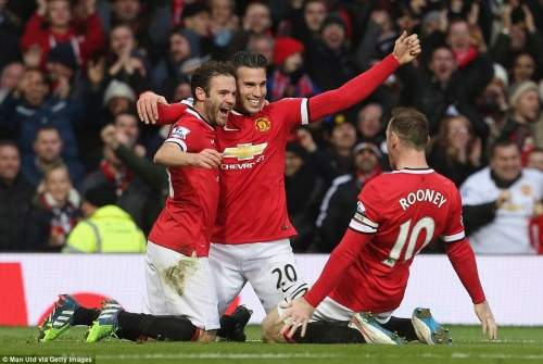 Wayne Rooney slides in to join his fellow goalscorers Juan Mata and Robin van Persie after the latter finished off their third against Liverpool