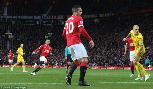 Robin van Persie (centre) and Liverpool's Martin Skrtel watch as Rooney's shot sails into the back of the net