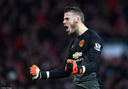 De Gea celebrates Rooney's goal moments after making the save from Sterling's point blank strike
