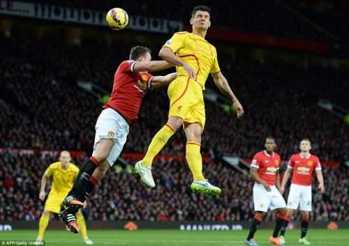 Liverpool defender Dejan Lovren rises highest for this header against United's Phil Jones