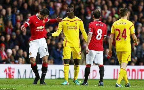 Mario Balotelli (second left), who came on for Lallana at the start of the second half, tugs on the shit of Van Persie