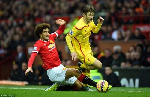 Marouane Fellaini is outpaced by Adam Lallana and finds himself in referee Martin Atkinson's book after this challenge